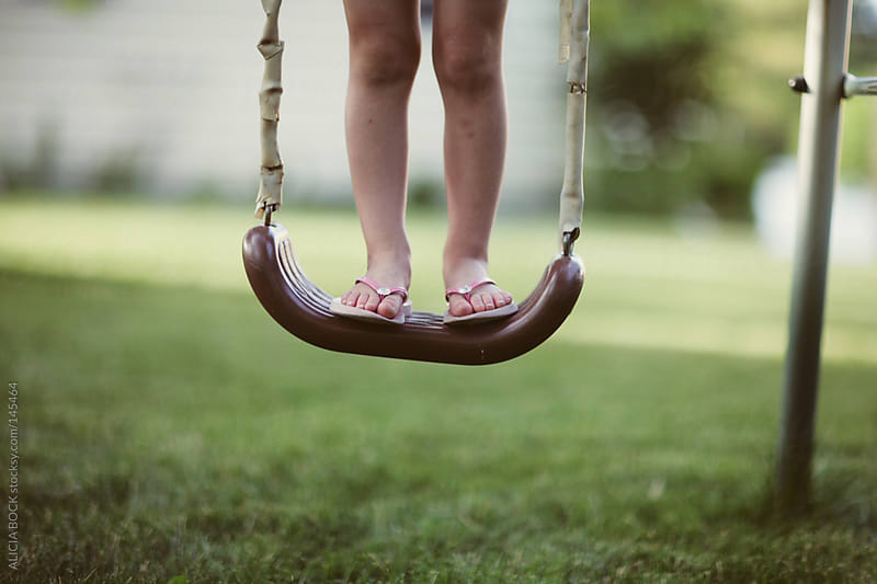 Feet on A Summer Swing by ALICIA BOCK for Stocksy United