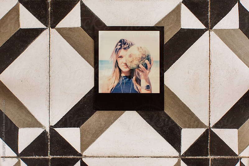 Polaroid of Young Blond Woman Holding Coconut on Vintage Tiles by Julien L. Balmer for Stocksy United