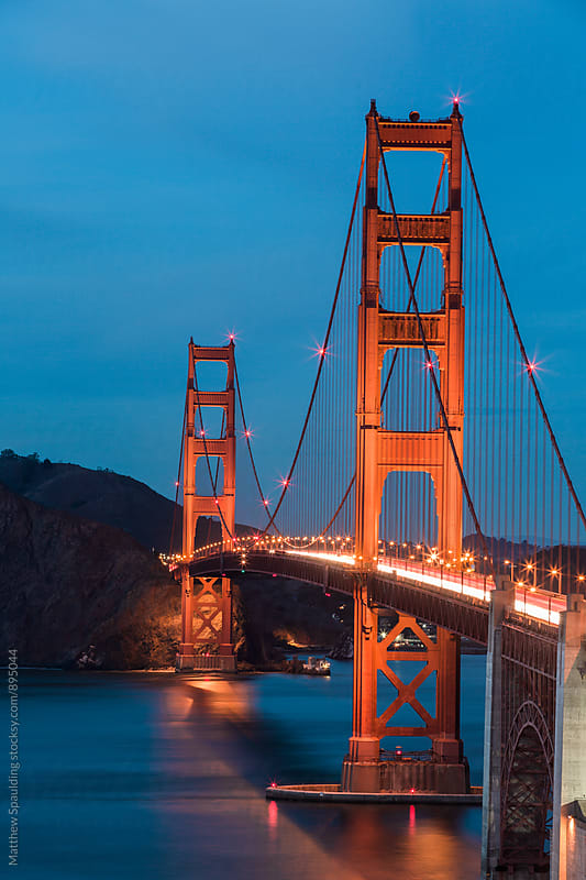Golden Gate Bridge at night with traffic by Matthew Spaulding for Stocksy United