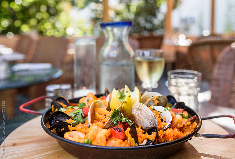 pan of paella in a restaurant by Deirdre Malfatto for Stocksy United