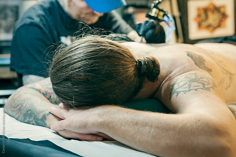 Tattoo Session: Getting Inked by Cameron Whitman for Stocksy United