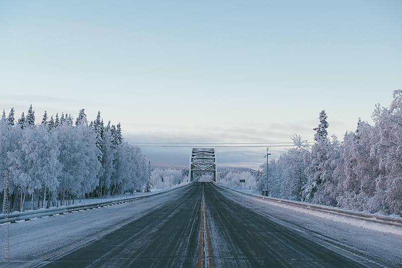 a bridge in winter, centered by Tara Romasanta for Stocksy United