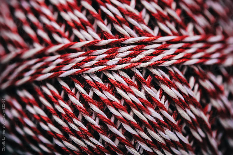 Detail of a Red and White Striped Thread by Claudia Lommel for Stocksy United