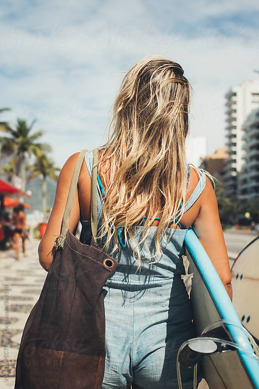 Rio de Janeiro - Slim Blond Girl Walking on Ipanema Beach With Surfboard from Behind by Julien L. Balmer for Stocksy United