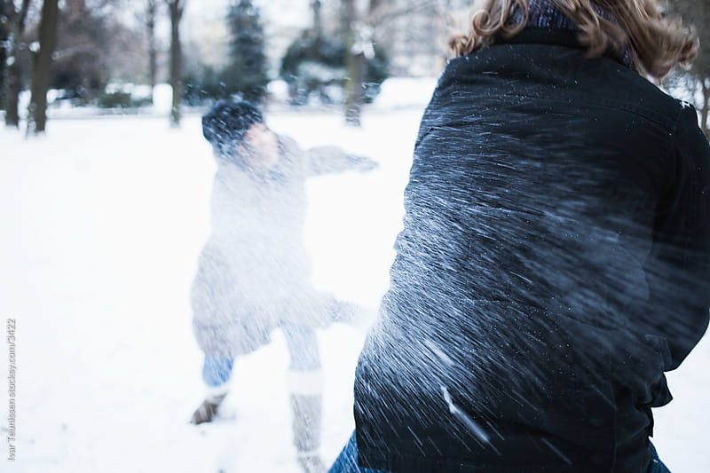Snowball fight: directhit. by Ivar Teunissen for Stocksy United