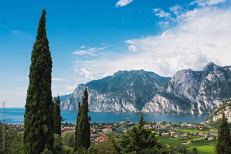 Distant view of Lake Garda with mountains in the background by Lea Csontos for Stocksy United