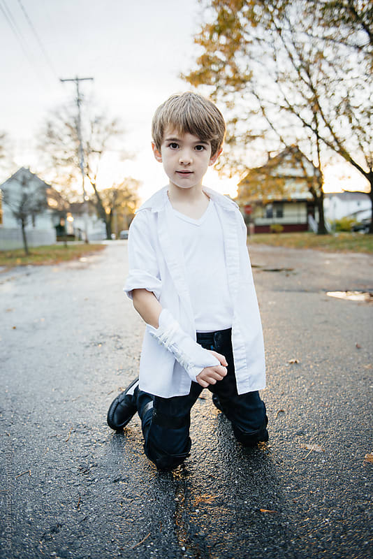Boy dances in the street by Cara Dolan for Stocksy United