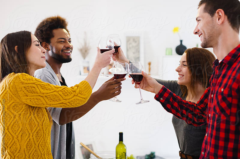 Group of young friends making a toast with glasses of red wine. by BONNINSTUDIO for Stocksy United