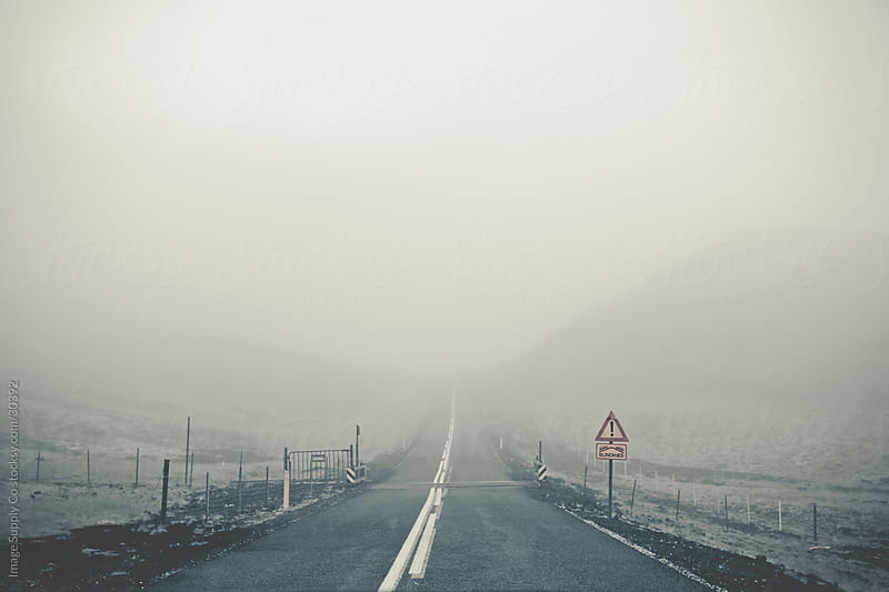 Straight road fades in fog in Iceland by Image Supply Co for Stocksy United