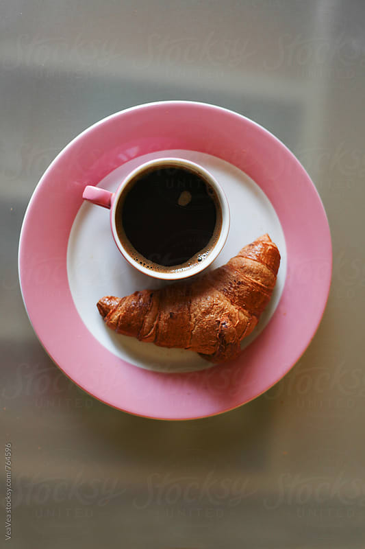 Cup of coffee and croissant from above  by VeaVea for Stocksy United