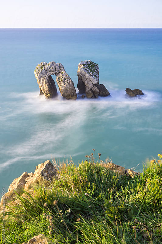 Arch-shaped rock in the sea by ACALU Studio for Stocksy United