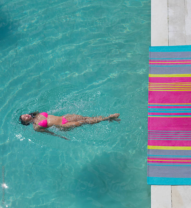 Woman swimming in Pool by Felix Hug for Stocksy United
