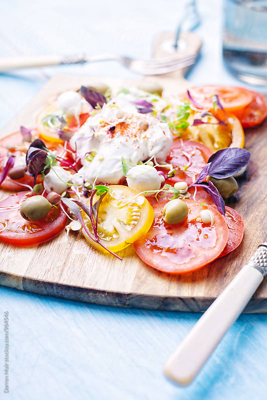 Colorful tomato salad. by Darren Muir for Stocksy United