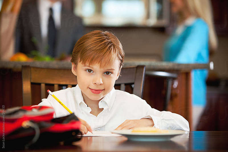 Family: Boy Happy to Do Schoolwork at Table by Sean Locke for Stocksy United