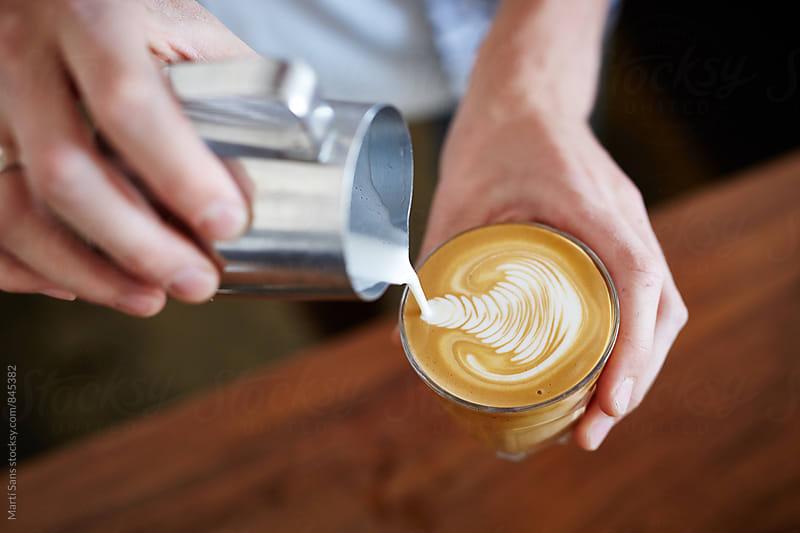 Close-up of bartender making latte by Martí Sans for Stocksy United