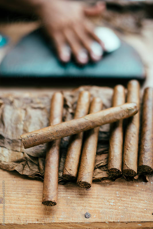 Close-up of pile of cuban cigars by Trent Lanz for Stocksy United
