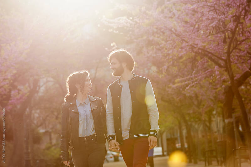 Romantic Couple Walking In Park by ALTO IMAGES for Stocksy United