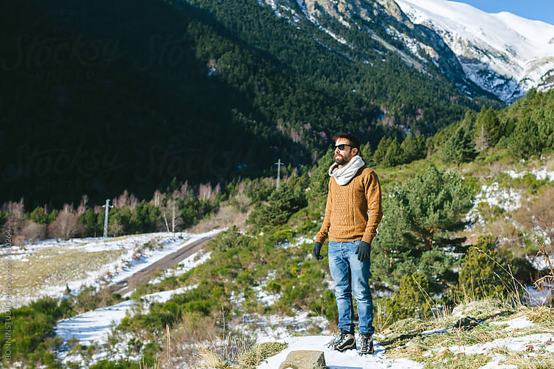 Young man looking a beautiful landscape in winter. by BONNINSTUDIO for Stocksy United