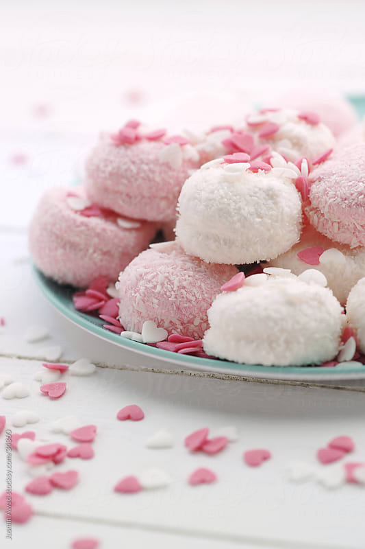 Sweet cakes in pink and white by Jasmin Awad for Stocksy United
