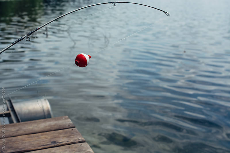 Fishing pole float by Gabriel (Gabi) Bucataru for Stocksy United