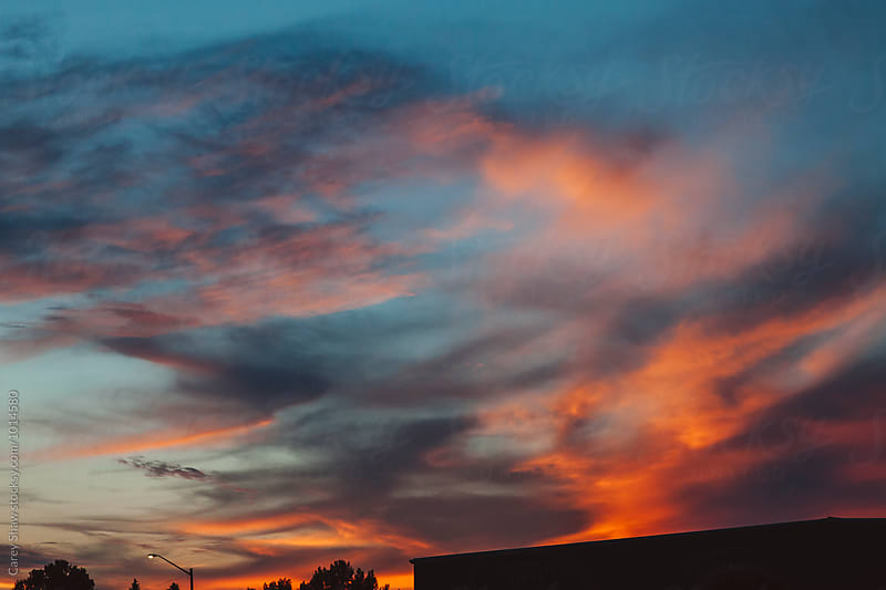 Colorful sky at sunset by Carey Shaw for Stocksy United