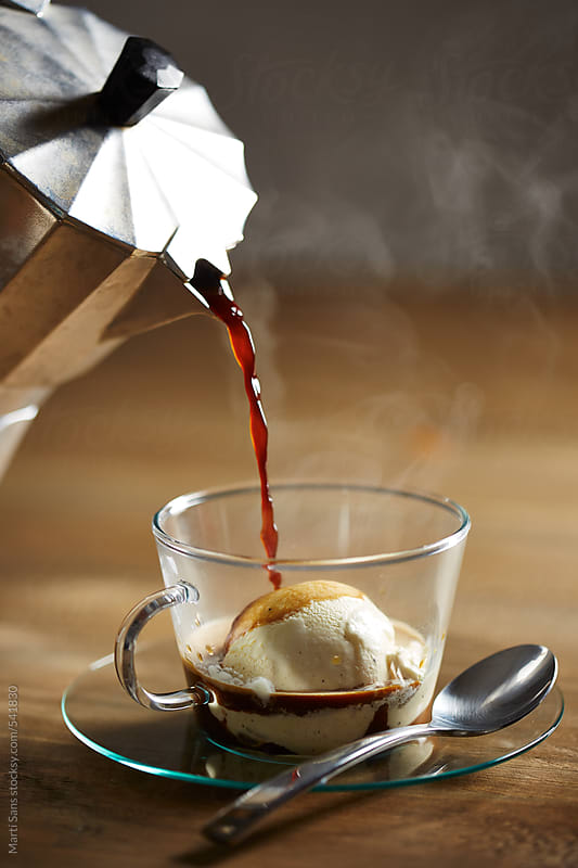 Pouring coffee on vanilla ice-cream  by Martí Sans for Stocksy United