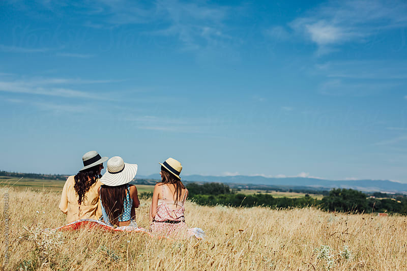Three Girls Relaxing in Nature by Lumina for Stocksy United