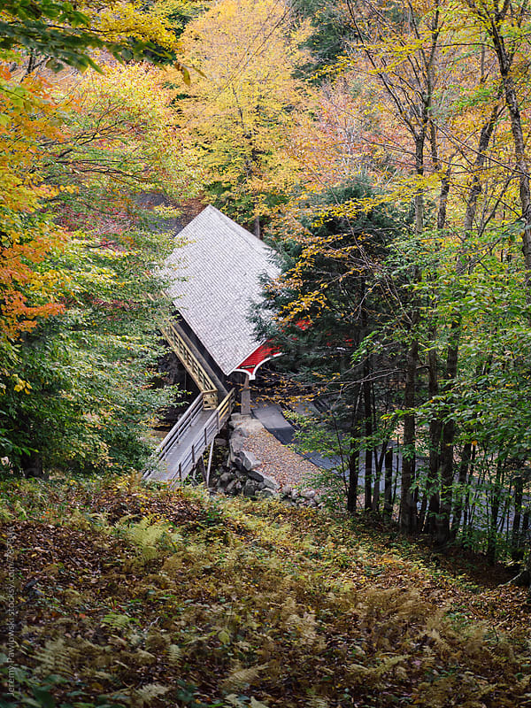 Covered bridge in with foliage. Autumn in New Hampshire by Jeremy Pawlowski for Stocksy United