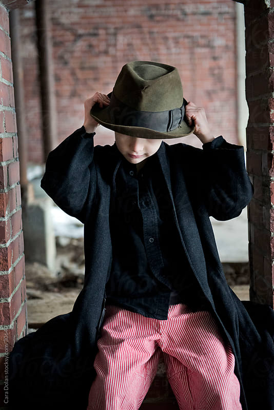 Boy adjusts his hat by Cara Slifka for Stocksy United