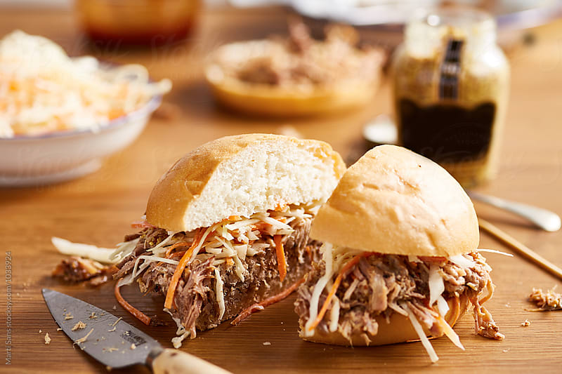 Cut hamburger with pulled pork by Martí Sans for Stocksy United