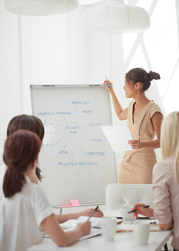 Businesswomen Devising a Business Plan by Lumina for Stocksy United