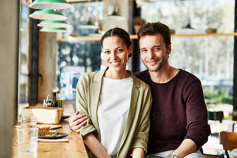 Loving Business Couple In Restaurant by ALTO IMAGES for Stocksy United