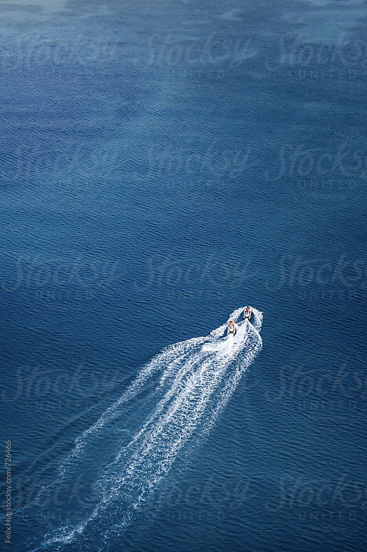 Two jetskies in tropical water by Felix Hug for Stocksy United