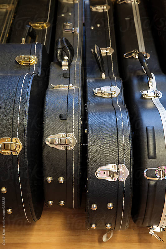 Guitar cases next to each other by Curtis Kim for Stocksy United