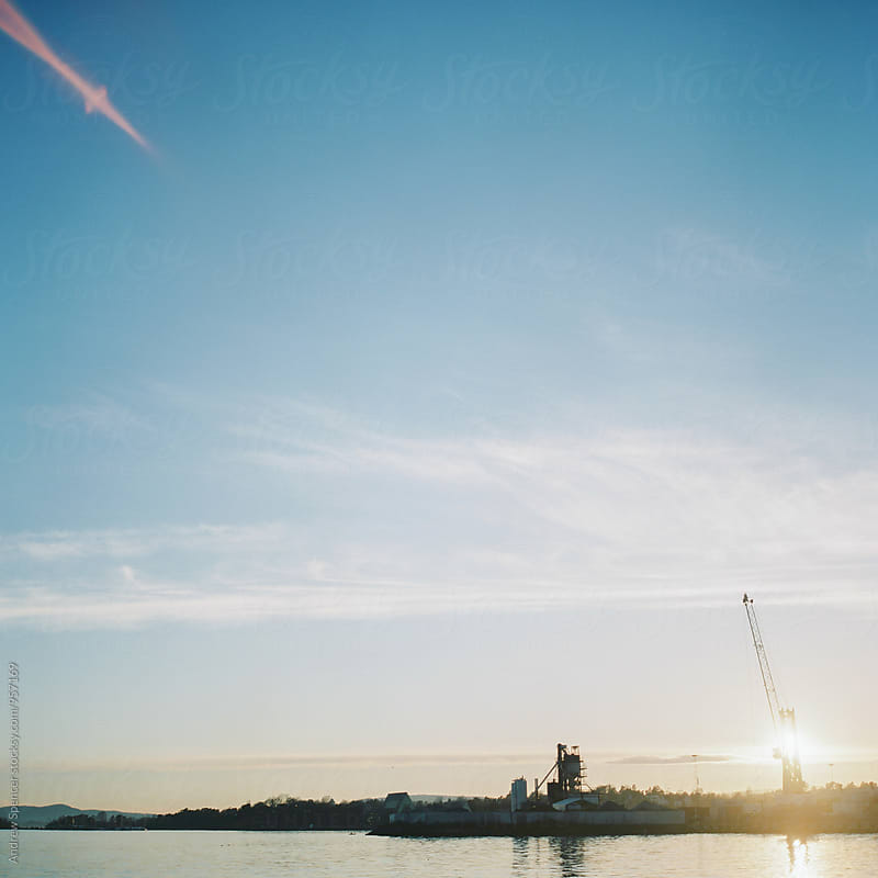 Sunset shining through a crane by Andrew Spencer for Stocksy United
