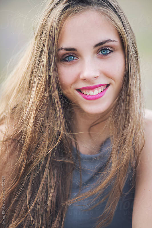 Portrait of a beautiful young woman smiling by Jovana Rikalo for Stocksy United