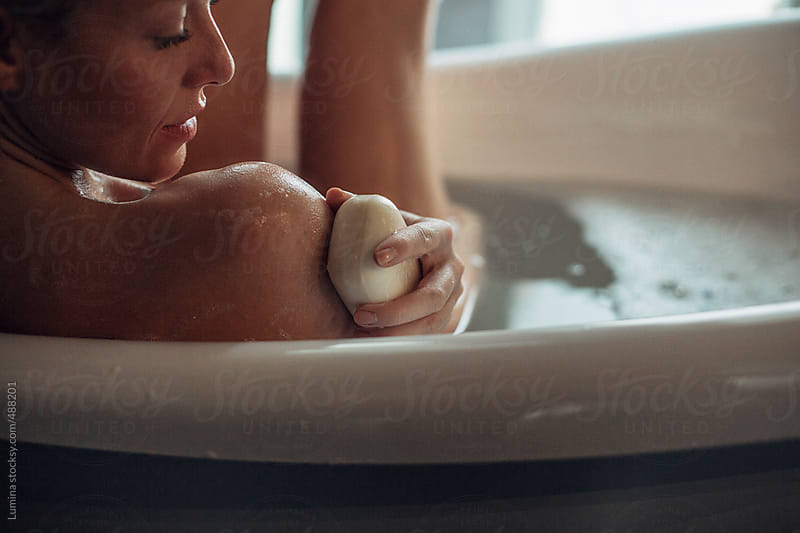 Woman Washing Her Shoulder With a Soap by Lumina for Stocksy United