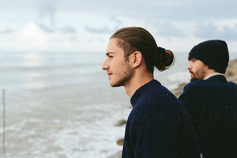 Two friends looking the ocean by Good Vibrations Images for Stocksy United