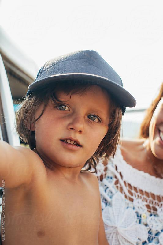 Cute Young Boy Wearing Blue Baseball Cap by Julien L. Balmer for Stocksy United