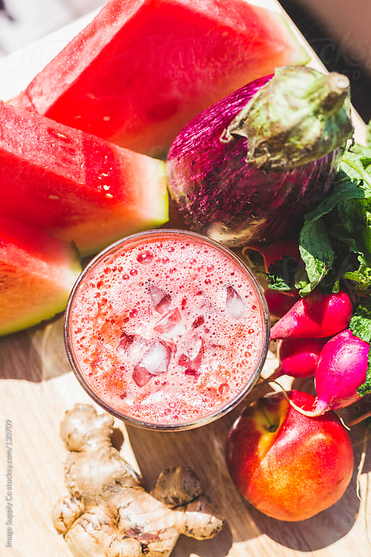 Red fruit and vegetable juice with fresh ingrediants on wooden board by Image Supply Co for Stocksy United