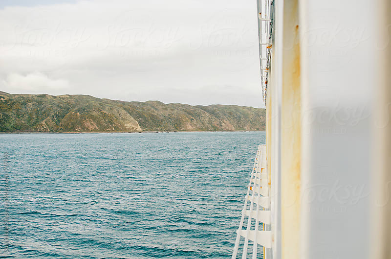 Ferry crossing islands in New Zealand by Dominique Chapman for Stocksy United