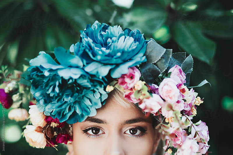 Young woman wearing flower crown by Jovana Rikalo for Stocksy United
