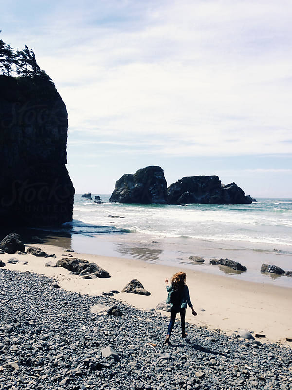 Woman Running on Oregon Coast by Kevin Russ for Stocksy United