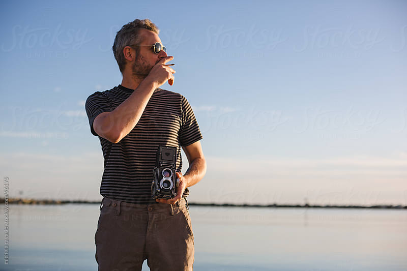 Man with his old film camera by michela ravasio for Stocksy United