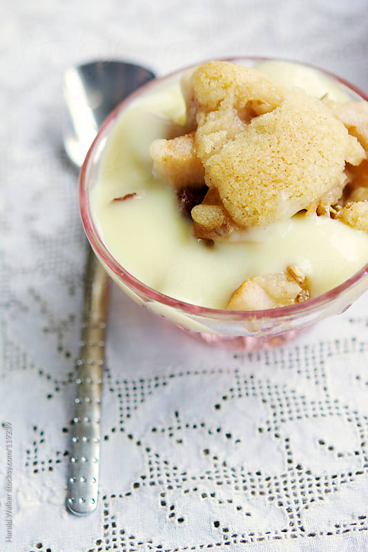 Pear crisp with Vanilla Soy custard sauce  by Harald Walker for Stocksy United