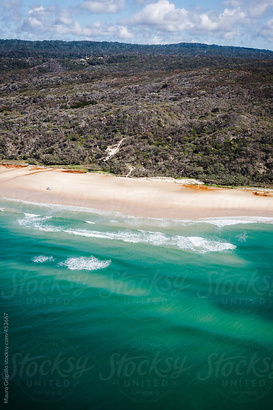 Flying on the coast. Australia. by Mauro Grigollo for Stocksy United