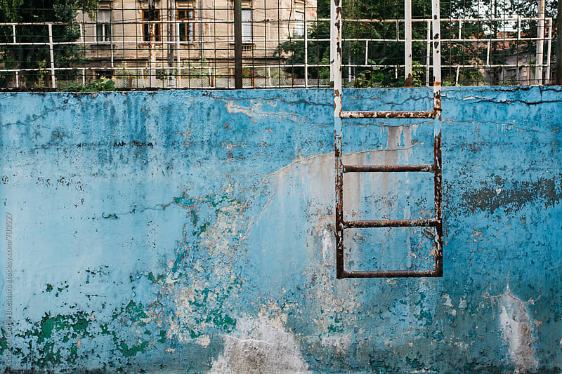 Rusty metallic ladder in a derelict swimming pool by Gabriel (Gabi) Bucataru for Stocksy United