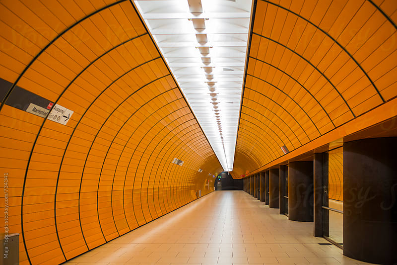A vast underground train station  by Maja Topcagic for Stocksy United