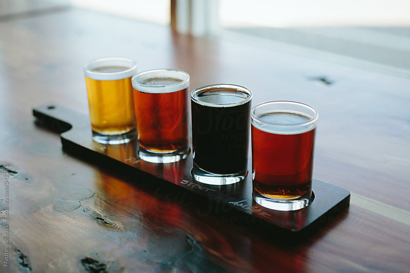 Micro brew beer flight by Matthew Spaulding for Stocksy United