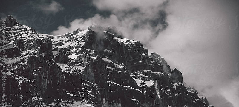 Hiking through a rocky mountain pass by Maximilian Guy McNair MacEwan for Stocksy United